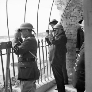 Winston Churchill viewing activity in the Channel from an observation post at Dover Castle during his tour of defences, 28 August 1940. Enemy air attacks were in progress at the time, and two German bombers were seen to crash into the sea.